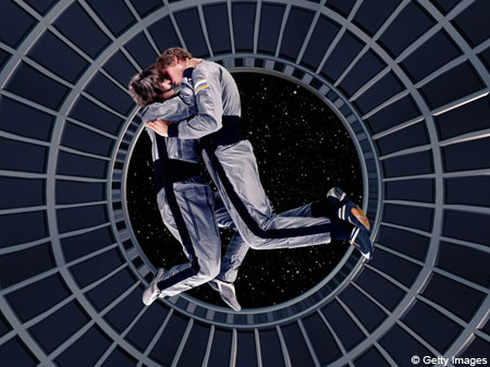 couple kissing space