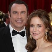 Pair held over Travolta 'cash plot'