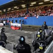 Riot police and Polish fans at Windsor Park