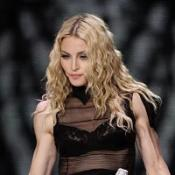 Madonna blames paparazzi for fall