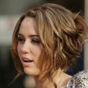 Miley breaks up with boyfriend
