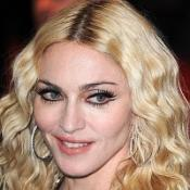 Madonna's new child flown to London