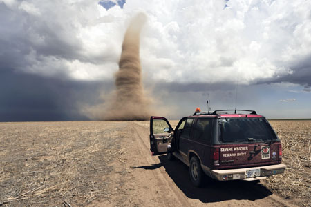 Dark skies: Storm chasers monitor a twister in Kansas