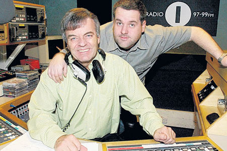 New sound: Chris Moyles gives veteran DJ Tony Blackburn a hug