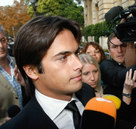 Central figure: Nelson Piquet Jr arrives at yesterday's hearing in Paris