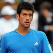 Djokovic eases through