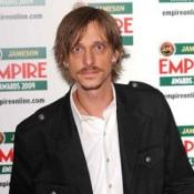 Mackenzie Crook has revealed how his star-struck son urged him to appear in BBC series Merlin