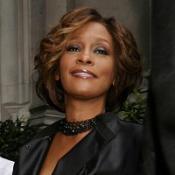 Whitney Houston told Oprah Winfrey that Bobby Brown spat at her