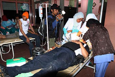Earthquake survivors receive medical treatment at a hospital in Padang Panjang, West Sumatra