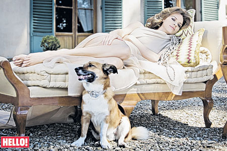 Relaxed: Hilary Swank poses for a Hello! magazine photoshoot in Italy