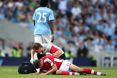 Van Persie was left bloodied after Emmanuel Adebayor's stamp in Man City's 4-2 win over Arsenal