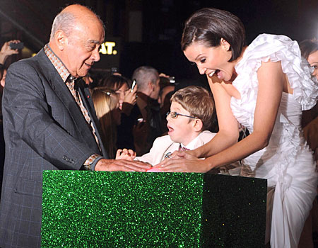 All white on the night: Dannii and Al Fayed light up Christmas with young fan
