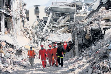 Rescuers search through the rubble in Sumatra