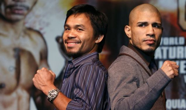 Manny Pacquiao (L) of the Philippines and WBO welterweight champion Miguel Cotto of Puerto Rico pose during a news conference at the MGM Grand hotel-casino in Las Vegas.
