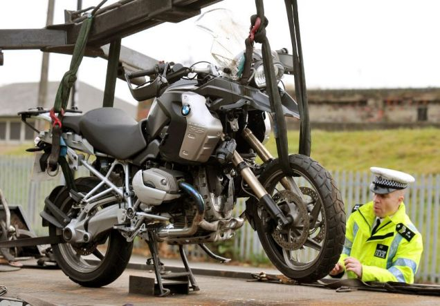 The motorcycle of Tottenham goalkeeper Carlo Cudicini is loaded onto a recovery truck after a crash with a car on Forest Road, Walthamstow, east London