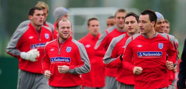 Wayne Rooney warms up with John Terry