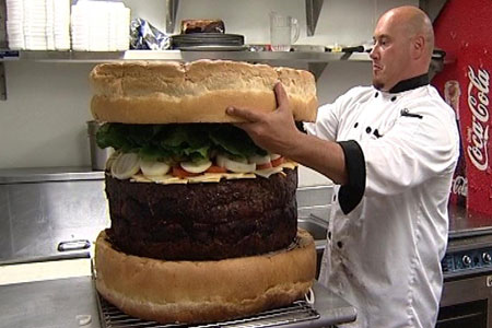 A light snack: Steve Mallie puts the finishing touches to the world's biggest burger