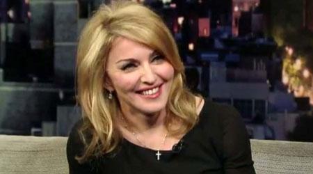 Madonna takes Mercy back to Malawi