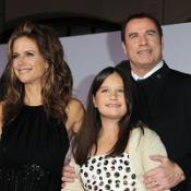 Fans applaud Travoltas at premiere