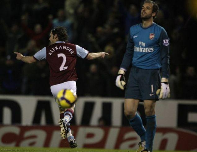 Graham Alexander wheels away after scoring against Arsenal.