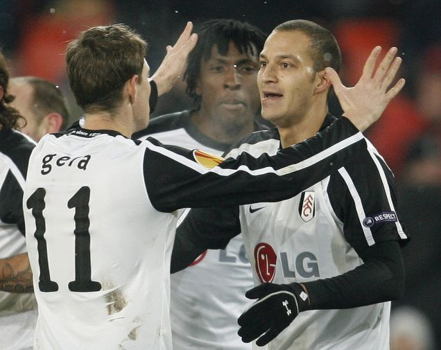 Fulham FC's Bobby Zamora (R) and team-mate Zoltan Gera celebrate after scoring against FC Basel