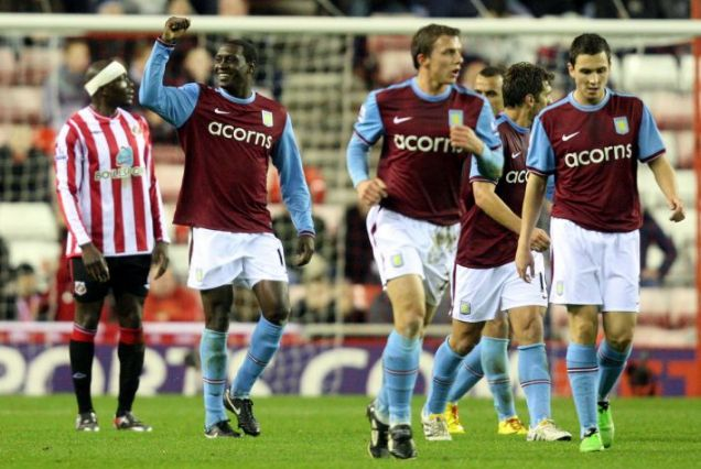 Aston Villa's Emile Heskey, second from left, reacts after scoring a goal against Sunderland