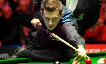 Selby fights back to regain title