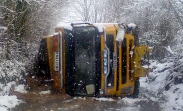 Gritter overturns on icy road near Lampeter, Wales