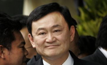 Thousands of Thaksin's angry supporters mass at opponent's home