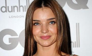 Miranda Kerr backs red-faced banker