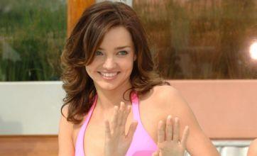Miranda Kerr shows off her curves in revealing pink Victoria's Secret bikini
