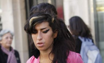 Amy Winehouse delays third album again