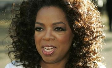 Oprah settles headmistress lawsuit