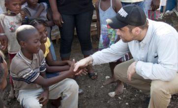Robbie Williams visits Haiti to help the 'vulnerable' homeless children