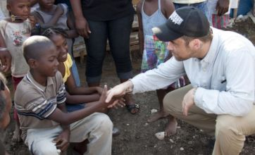 Robbie Williams visits Haiti to help the 'vulnerable' homeless children