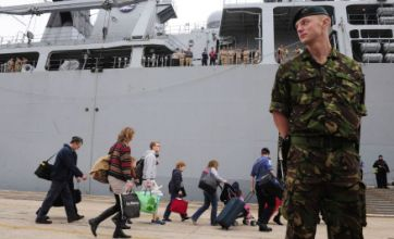 Navy warships save tourists and troops stranded in Spain