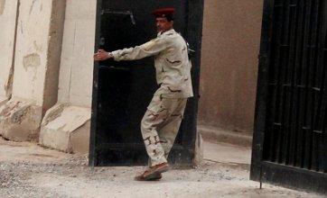 Shiite Muslims torture Sunnis at secret Iraqi prison camp