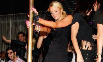 Paris Hilton pole dances and puts Doug Reinhardt behind her