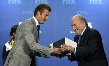 David Beckham hands over World Cup 2018 bid book to Fifa's Sepp Blatter