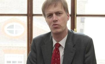 Woman held after MP Timms stabbed
