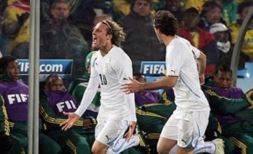 Diego Forlan's double stuns ten-man South Africa