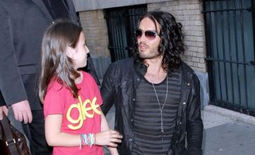 Russell Brand poses for a photo with a little lady – and it's not Katy Perry