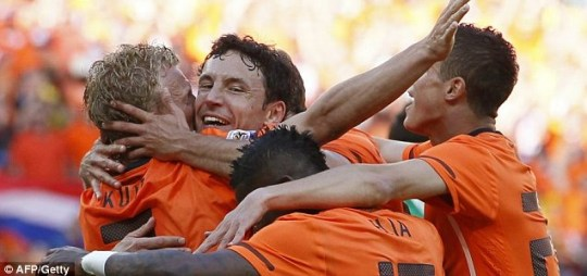 The Dutch celebrate their opening World Cup win over Denmark