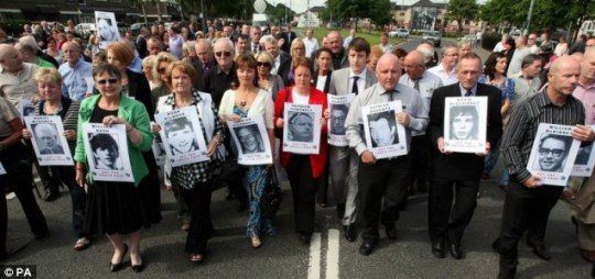 Relatives of those shot dead on Bloody Sunday marching in silence in Londonderry