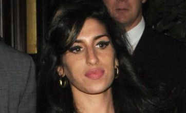 Amy Winehouse bursts out of her dress on date night with Reg Traviss