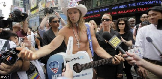 The Naked Cowboy, aka Robert Burck, holds and almost-naked news conference in New York's Times Square