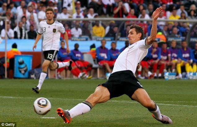 Miroslav Klose of Germany scores the opening goal past David James