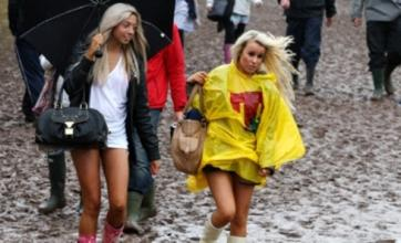 Eminem shows up late at rain-soaked T in the Park