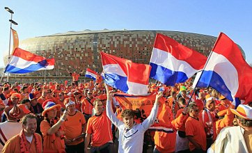 Holland fans prepare to make World Cup final against Spain 'Oranje' affair