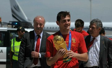 Spain arrive back in Madrid with World Cup trophy